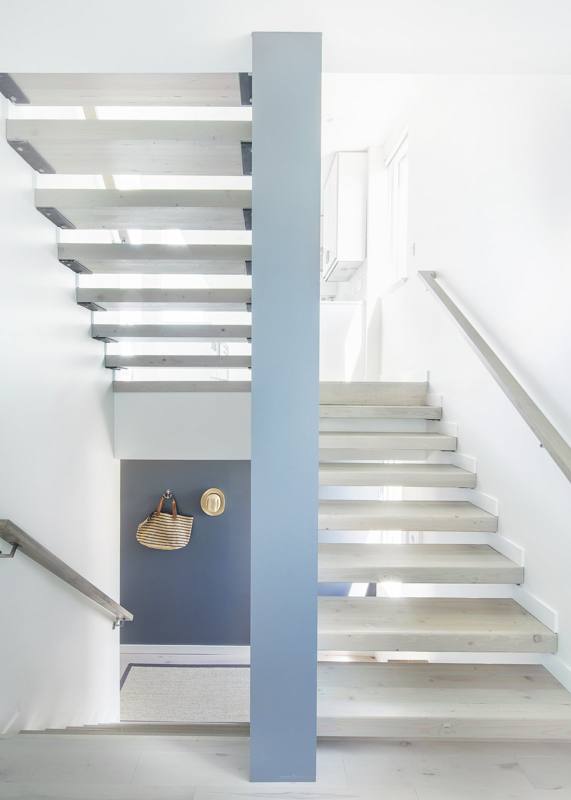 Stair Tagged: Staircase, Wood Tread, and Wood Railing.  Sea Bright House by Jeff Jordan Architects
