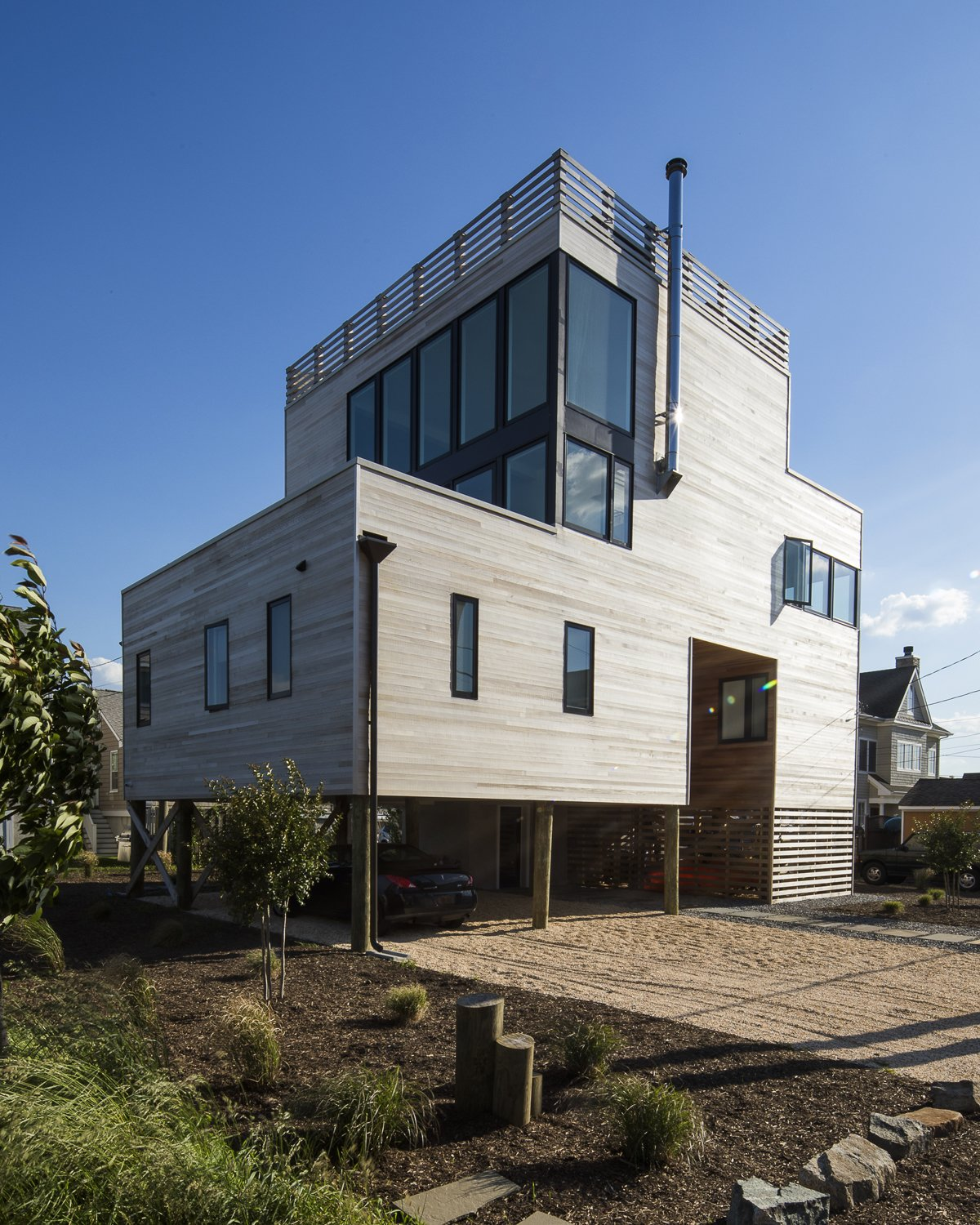 Northeast exterior Tagged: Outdoor, Front Yard, Grass, and Walkways. Sea Bright House by Jeff Jordan Architects