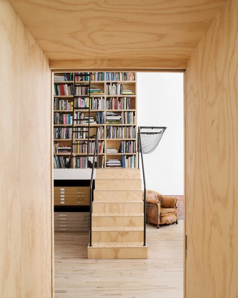 """Modern home with staircase, wood tread, and metal railing. Plywood organizing """"spine"""" threshold between living space and studio space Photo 8 of Wells Fargo Loft"""