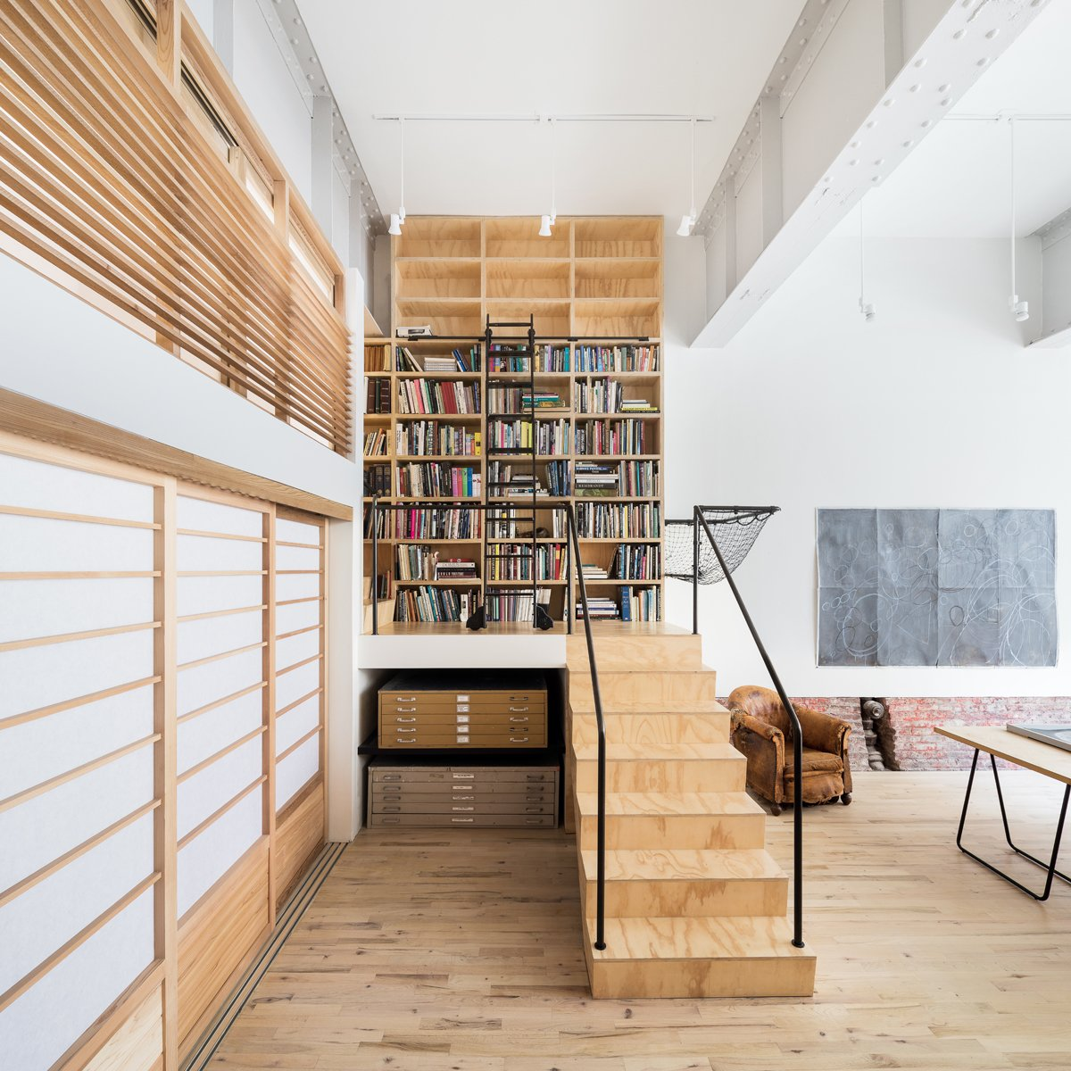 Studio space and stair Tagged: Office, Library, Craft Room, Study, Chair, Light Hardwood Floor, Bookcase, and Shelves.  Wells Fargo Loft by Jeff Jordan Architects