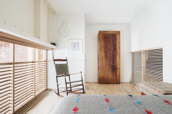 Modern home with bedroom, wardrobe, bed, chair, night stands, recessed lighting, and light hardwood floor. Loft bedroom Photo 11 of Wells Fargo Loft