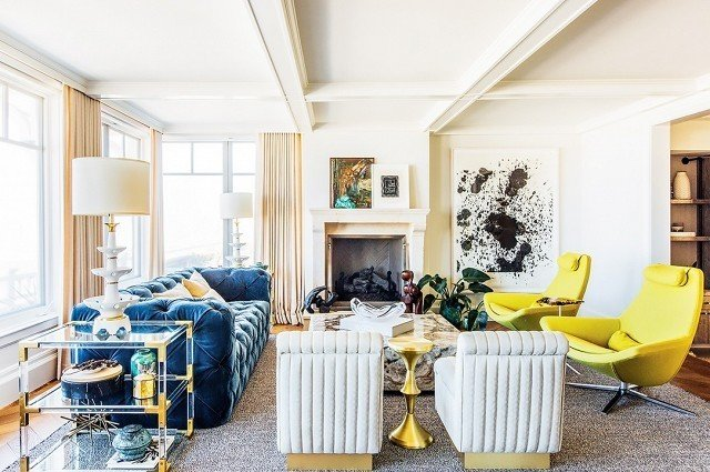 Say hello to a yellow that's anything but mellow. In this elegantly glam living room, the pair of lemon chairs packs a zesty punch. The chartreuse shade complements the rich upholstered textures, sleek stone, and metallic surfaces to create a light, fresh feeling. Design by Megan Tagliaferri #chartreuse #colorcrush #color #yellow #design #mydomaine