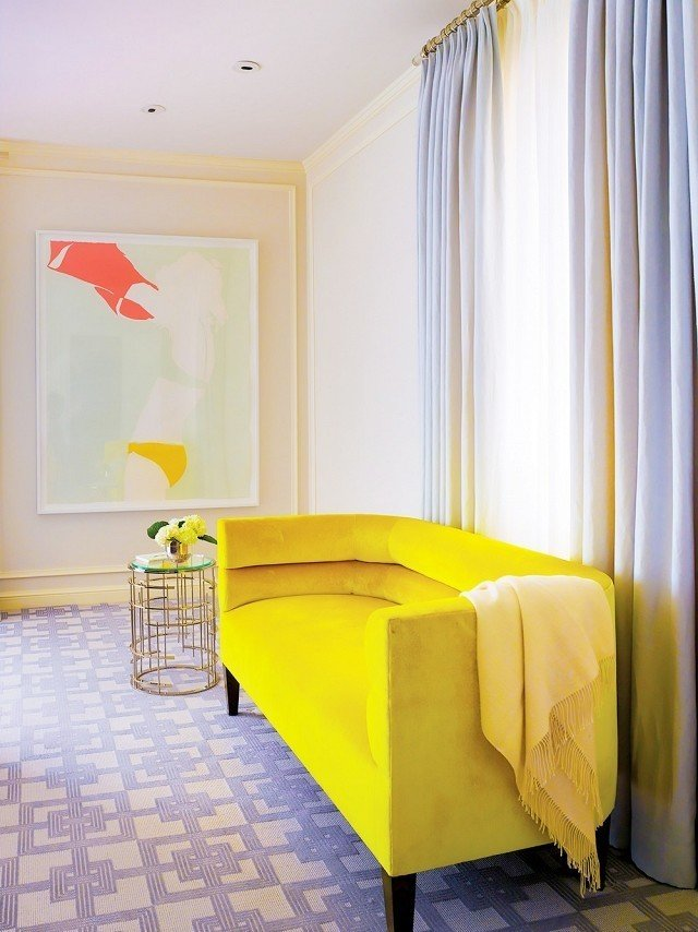 This chartreuse settée is just golden enough to add warmth and sunshine-y color to this bedroom space.  #chartreuse #colorcrush #color #yellow #design #mydomaine  Photo by Matthew Millman  Design by Palmer Weiss  Our Latest Color Crush is Perfect for Summer by MyDomaine