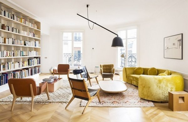 This curvy vintage velvet moment feels ripe and rich in a deeper chartreuse shade. Surrounded by midcentury furnishings, this darker yellow sofa projects sophisticated confidence, the kind that only improves with age.  Photo courtesy of Studio CMP  #chartreuse #colorcrush #color #yellow #design #mydomaine  Our Latest Color Crush is Perfect for Summer by MyDomaine