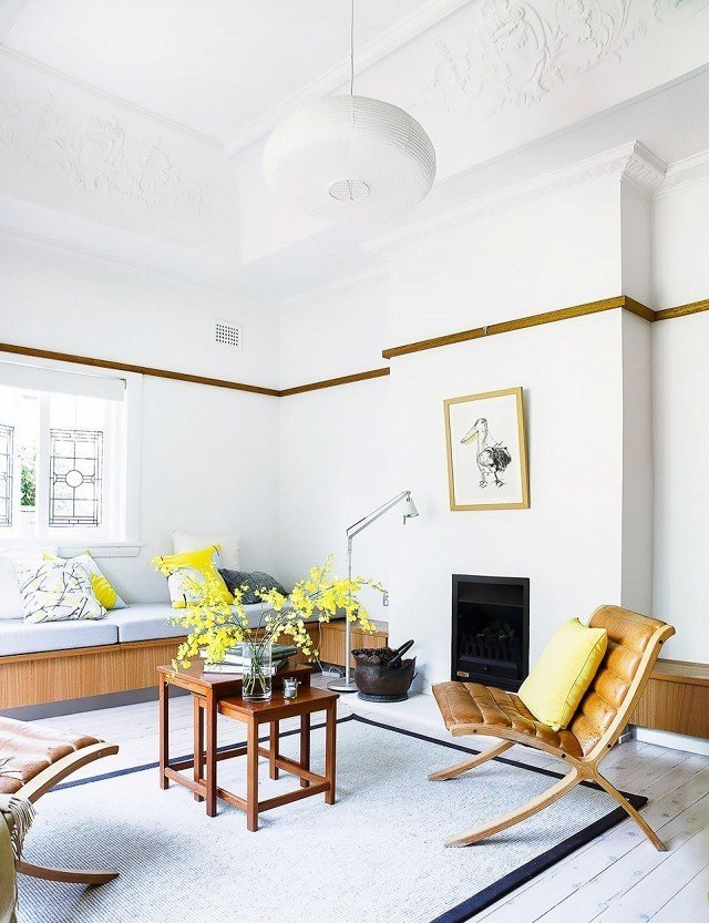 A light and lemony lounge space is the perfect place to soak up morning sunshine. Because lemon water in the morning is best enjoyed among tart yellow pillows and bright flowers in full bloom.  Photo by Maree Homer for Homes to Love  #chartreuse #colorcrush #color #yellow #design #mydomaine   Photo 4 of 13 in 15 Flower Arrangements That Will Brighten Your Home on Valentine's Day from Our Latest Color Crush is Perfect for Summer