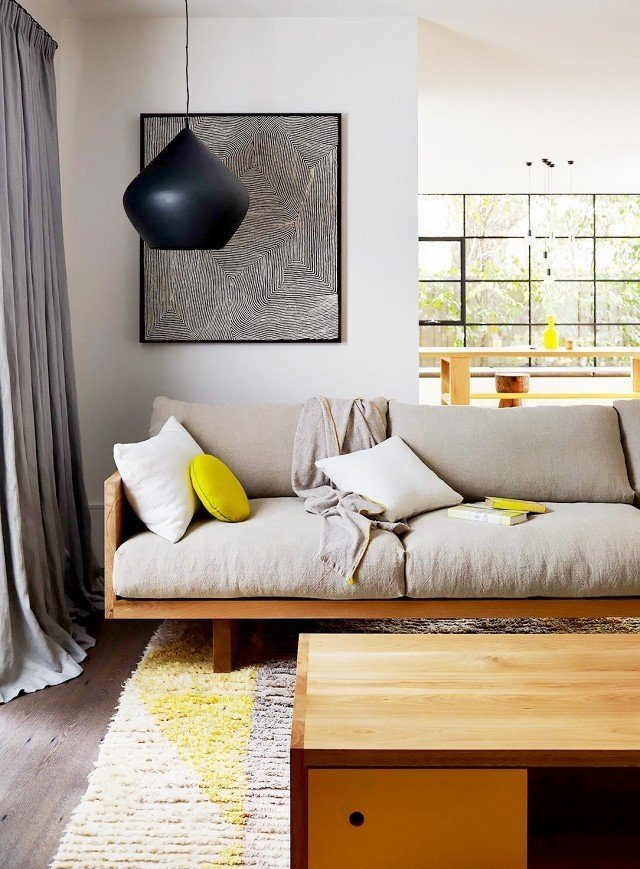 Pillows and poufs make for perfect acidic accessories. In this home, chartreuse décor accents keep the eye dancing from surface to surface, creating color cohesion throughout. Each piece feels purposeful in connecting one room to the next.  Photo by Mark Tuckey  #chartreuse #colorcrush #color #yellow #design #mydomaine