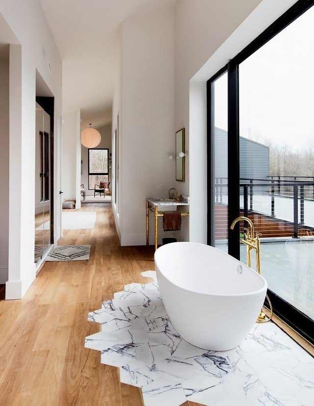 How to Use Modern Home Decor in Unexpected Ways - Photo 3 of 9 - It might look complicated, but Studio DB's Britt and Damian Zunino, the duo behind this stunning bathroom space, say transitioning tiles to wooden floorboards is surprisingly straightforward.