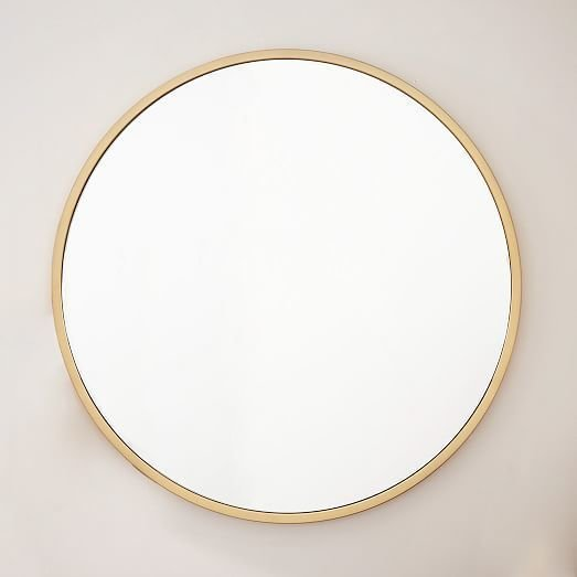 West Elm Metal Framed Oversized Round Mirror ($499)  Photo 4 of 19 in Tour an Insanely Stylish NYC Loft With Major Scandinavian Vibes