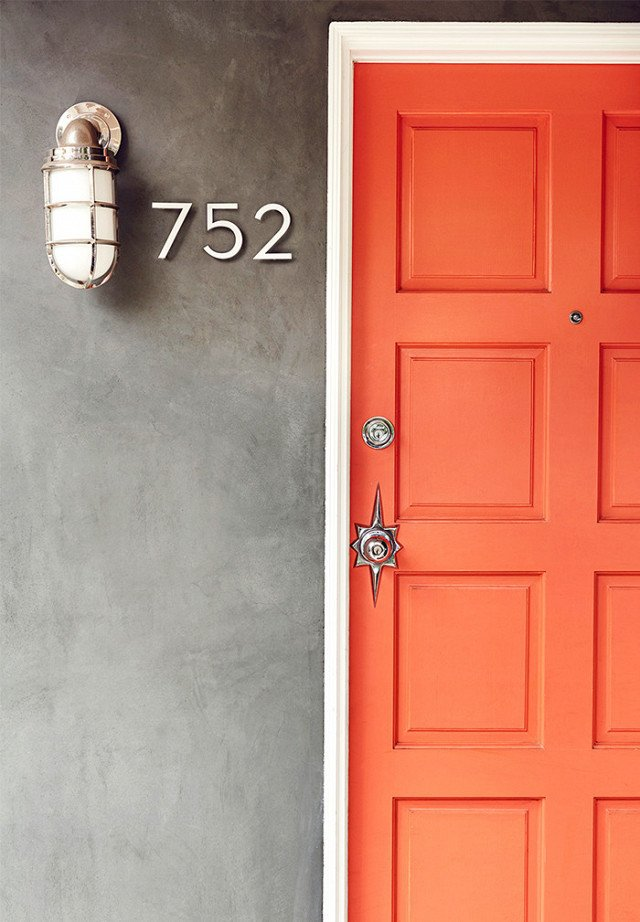 This front door should be all the proof you need to decide that when it comes to doors, orange is the new black. It might be brunch feelings talking, but the bright hue reminds me of a perfect blood-orange mimosa. Needless to say, I've personally got a little orange crush on this one.  Photo 6 of 23 in What's the Best Color to Paint Your Front Door? Your Guide to Finding The One