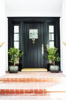 What's the Best Color to Paint Your Front Door? Your Guide to Finding The One - Photo 17 of 22 - This is a door we adore. There's something so stylishly simple about a classic black door and frame that reminds us it's time to step up.