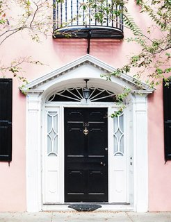 What's the Best Color to Paint Your Front Door? Your Guide to Finding The One - Photo 7 of 22 - Knock, knock. Who's there? A fresh front door color combination. It doesn't get more classic that a jet-black front door, but in this case, the blush walls give the traditional shade a trendy new twist.