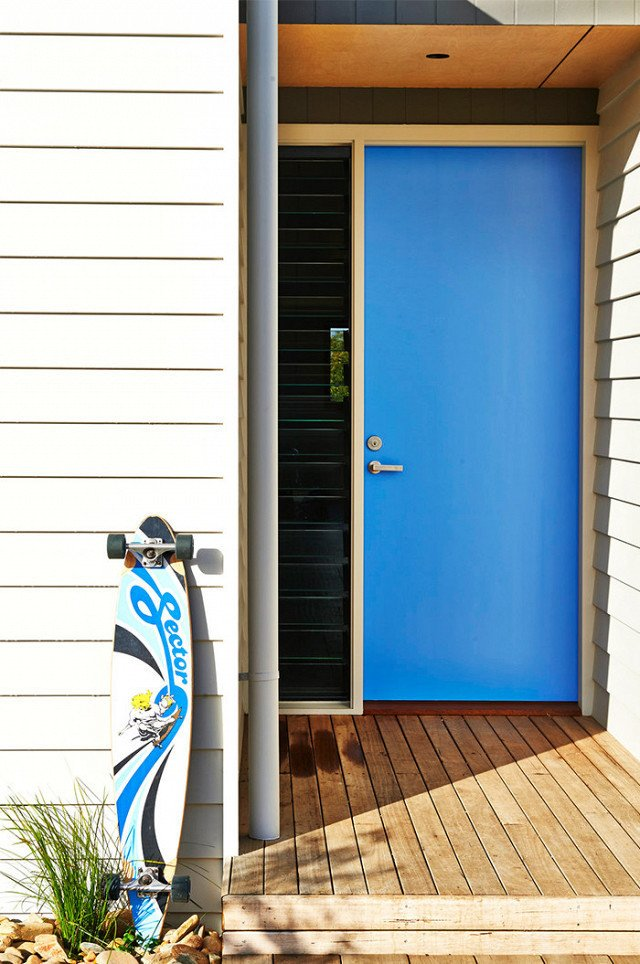 When you have a clear favorite color, it's a no-brainer to paint your front door. And it's hard to beat the cool factor that comes from a vibrant blue front door like this one. The shade is a modern mid-blue that's not too light and not too dark. Best of all, it connects back to the accent colors in other favorite items like the owner's longboard.  Photo 12 of 23 in What's the Best Color to Paint Your Front Door? Your Guide to Finding The One
