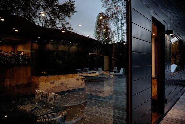 Modern home with kitchen, marble counter, slate floor, granite counter, wood cabinet, stone slab backsplashe, recessed lighting, range, and range hood. Photo 2 of Sherwood Forest