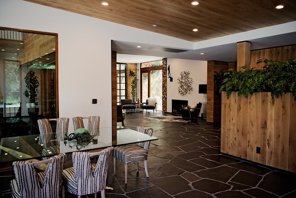 Modern home with dining room, chair, table, recessed lighting, slate floor, and wood burning fireplace. Photo 5 of Sherwood Forest