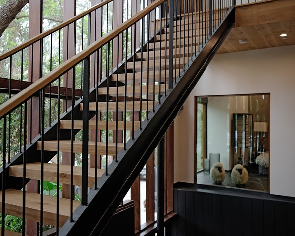 Modern home with staircase, wood tread, and metal railing. Photo 8 of Sherwood Forest