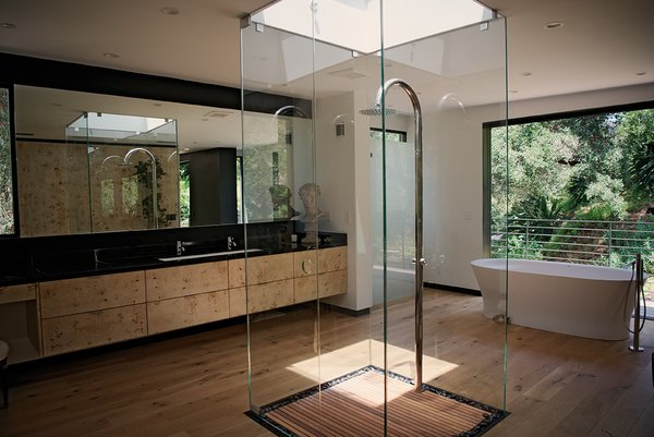 Modern home with bath room, marble counter, medium hardwood floor, undermount sink, freestanding tub, enclosed shower, and recessed lighting. Photo 12 of Sherwood Forest