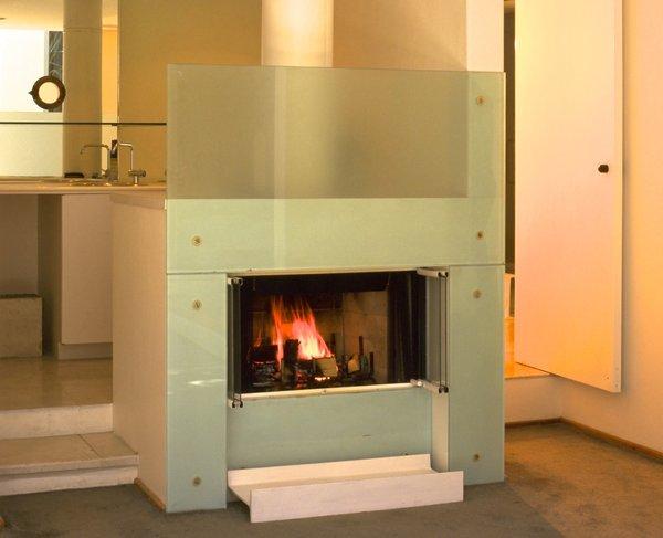 Glass fireplace bar behind Photo  of Casa Lila modern home