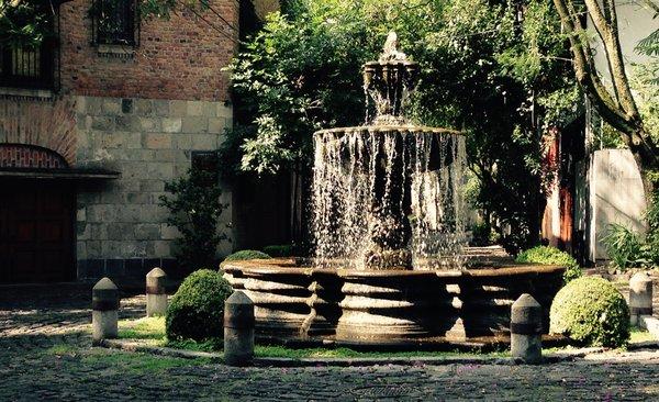 Exterior fountain at the corner. Photo 16 of Casa Lila modern home