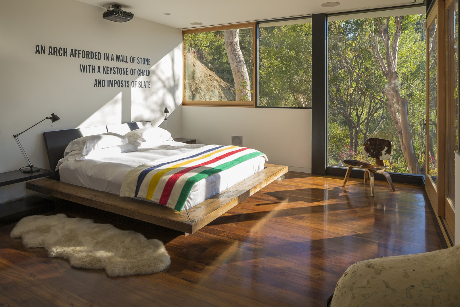 Tagged: Bedroom, Chair, Table Lighting, Bed, and Medium Hardwood Floor.  Sycamore House by ANX / Aaron Neubert Architects