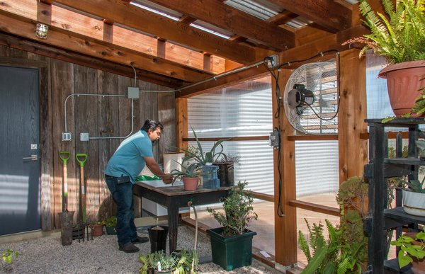 A small greenhouse is attached to the garage. The vintage barn wood on the back wall was salvaged from an old barn on the ranch that had fallen down decades ago. Photo 10 of The Goat Sheds modern home