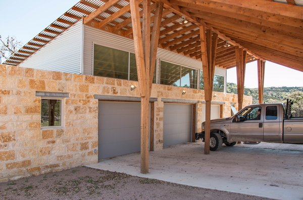 All the sheds, including the garage, have clerestory windows. The carport and garage can be emptied of cars and used as a large, covered space for outdoor parties.  Photo 15 of The Goat Sheds modern home