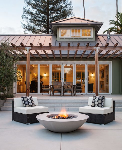 The generous outdoor living area has room for dining and relaxation.  By Arterra Landscape Architects Photo 2 of Talk of the Neighborhood modern home