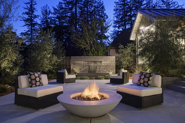 The fountain adds a pleasant sound to evening gatherings.  By Arterra Landscape Architects Photo 6 of Talk of the Neighborhood modern home