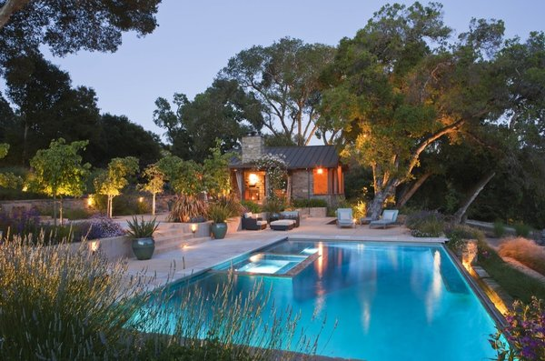 The landscape is illuminated in the evenings, providing an ethereal quality and extending the use and enjoyment of the gardens.    By Arterra Landscape Architects. Photo by Michele Lee Willson Photo 2 of Homestead on Whiskey Hill modern home