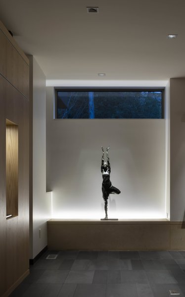 Modern home with living room, accent lighting, wall lighting, porcelain tile floor, and floor lighting. Living Room sculpture plinth: Bronze Sculpture by Gail Folwell Photo 2 of the Duncan Residence