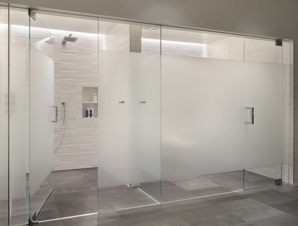 Modern home with bath room, porcelain tile floor, recessed lighting, enclosed shower, ceramic tile wall, ceiling lighting, accent lighting, and one piece toilet. Master Bath: Shower and Toilet rooms Photo 7 of the Duncan Residence