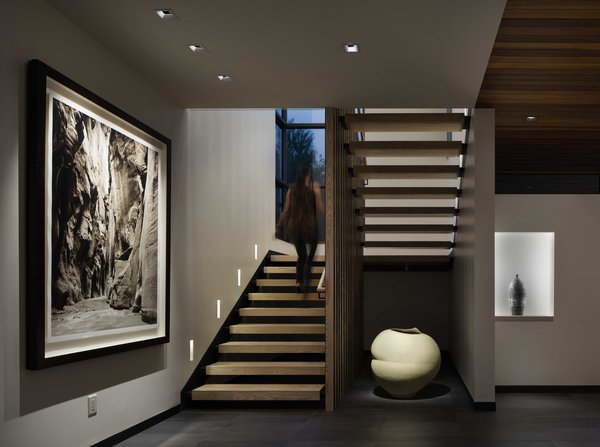 Modern home with staircase, wood railing, wood tread, and metal railing. South Stair Photo 4 of the Duncan Residence