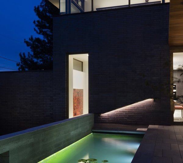 Modern home with outdoor, tile patio, porch, deck, small pool, back yard, hardscapes, landscape lighting, and flowers. Koi pond at West Patio Photo 9 of the Duncan Residence