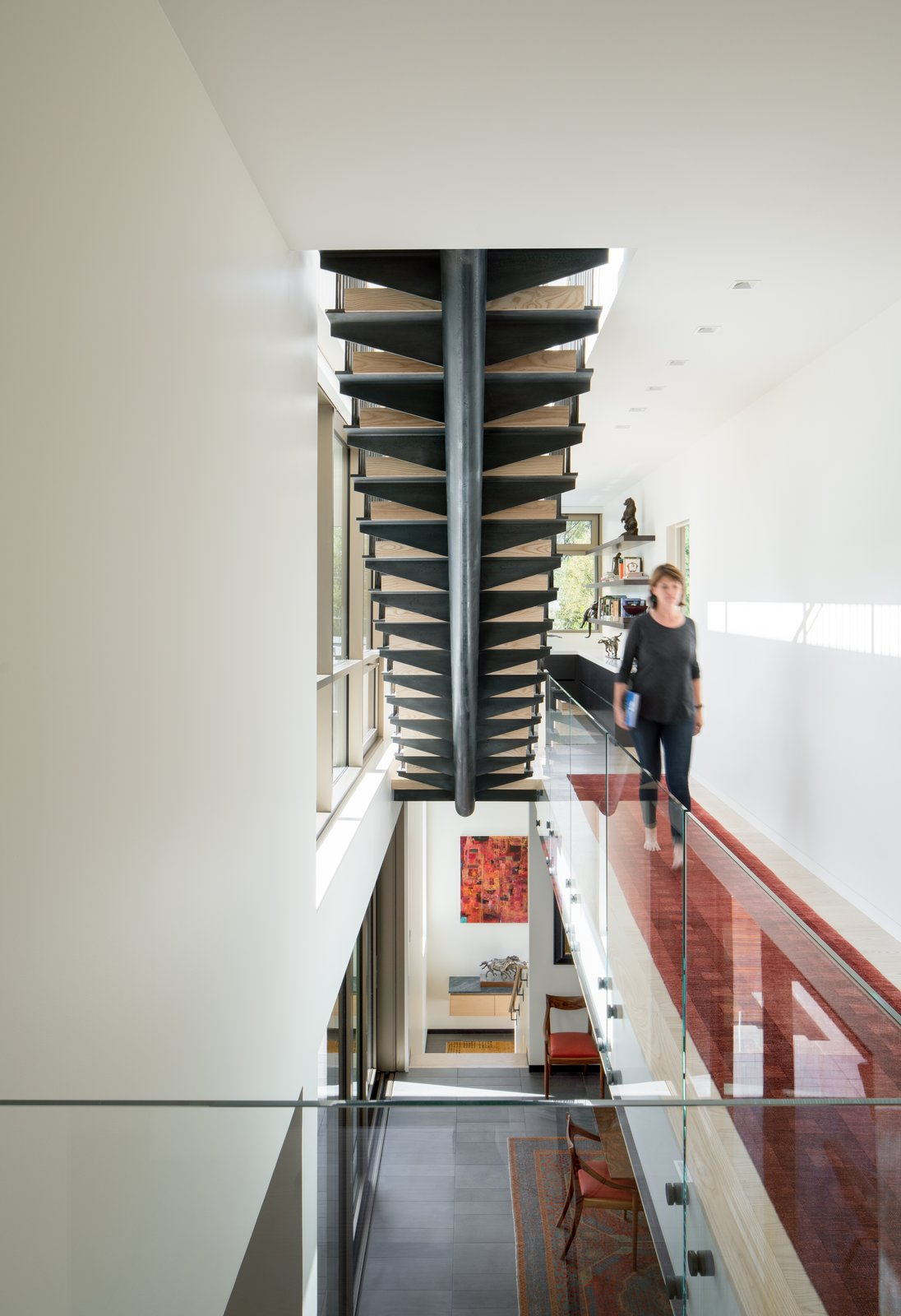 Stair to Roof Tagged: Staircase, Metal Tread, Wood Railing, Wood Tread, Glass Railing, and Metal Railing.  the Duncan Residence by Tom Gallagher