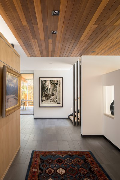 Modern home with hallway and porcelain tile floor. Entry Foyer Photo 8 of the Duncan Residence