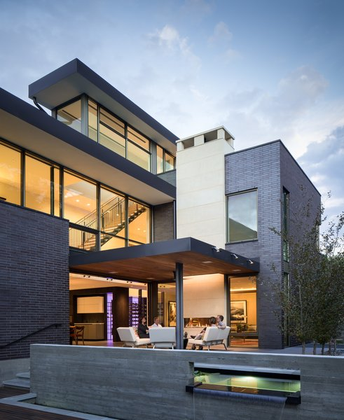 Modern home with outdoor, back yard, trees, raised planters, walkways, small pool, large patio, porch, deck, tile patio, porch, deck, and landscape lighting. View of West Patio Photo 12 of the Duncan Residence