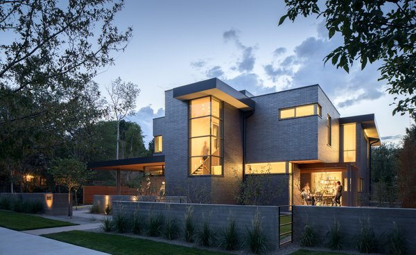Modern home with outdoor, trees, side yard, front yard, walkways, hardscapes, raised planters, small patio, porch, deck, decking patio, porch, deck, tile patio, porch, deck, metal fence, horizontal fence, and landscape lighting. View from the Street, from Southeast Photo 11 of the Duncan Residence
