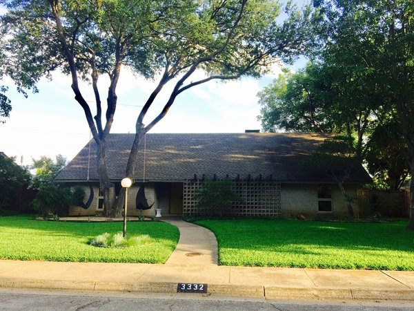 Modern home with outdoor, front yard, grass, large patio, porch, deck, lap pool, pavers patio, porch, deck, trees, stone patio, porch, deck, and wood patio, porch, deck. Front of Disco 3332 Photo  of Disco 3332 in Dallas, TX