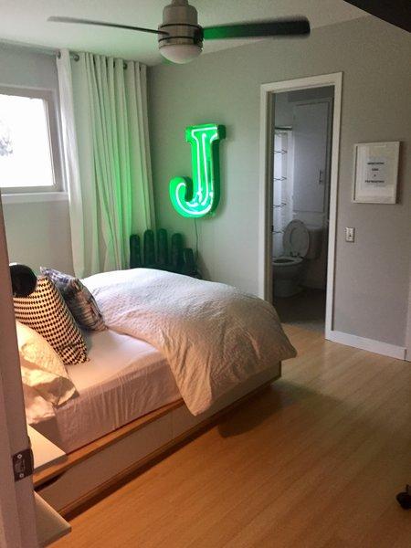 Modern home with bedroom, bed, ceiling lighting, floor lighting, wall lighting, and light hardwood floor. Guest Bedroom 2 Photo 3 of Disco 3332 in Dallas, TX