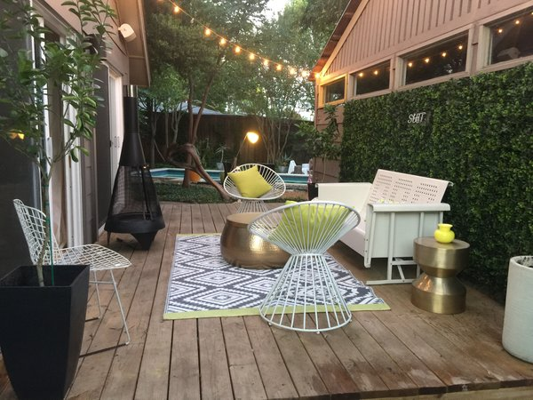Modern home with outdoor, grass, trees, lap pool, back yard, large patio, porch, deck, wood patio, porch, deck, pavers patio, porch, deck, wood fence, landscape lighting, and hanging lighting. Deck at Disco 3332 Photo 19 of Disco 3332 in Dallas, TX