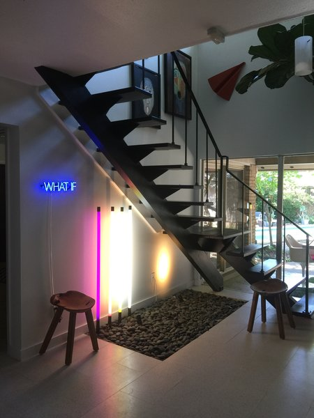 Modern home with staircase, metal railing, and wood tread. Floating Staircase Photo 16 of Disco 3332 in Dallas, TX