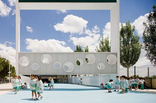 10 Playgrounds With Modern Twists - Photo 1 of 10 - This airy dreamscape was imagined and designed by Spanish architects Eduardo Navadijos and Csaba Tarsoly in the city of Boadilla del Monte. Clean facades and wide pavilions make for a sunny yet protective structure. It's perfect for uninhibited fun on summer days.