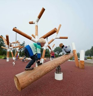 Perfect for all ages, this CEBRA-designed playground is equal arts practical and whimsy.  Denmark's Pulse Park playground is a life-sized geometric garden of interactive equipment. Itces whimsical aesthetic contrasts the otherwise calm landscape of Kildebjerg Ry. It encourages playful athleticism as well as tranquil relaxation.