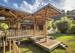 This island playhouse is integrated into its tropical environment. The Bamboo Playhouse in Kuala Lumpur  is located in the middle of lush gardens and is constructed with traditional Malaysian techniques. Architect Eleena Jamil used traditional materials for a modern application. Bamboo serves as an extremely strong, ventilated, and airy material to compose this 320-square-meter space.