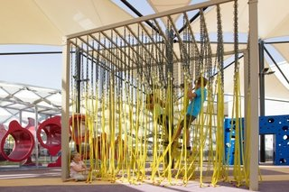 10 Playgrounds With Modern Twists - Photo 8 of 10 - This Abu Dhabi playground compartmentalizes the senses within each interactive unit. This four-part playground is located in the popular and exquisite Hazza Bin Zayed Stadium and was designed by Free Play creative studio. People of all ages are encouraged to swing, crawl, and feel their way through each shaded experience.