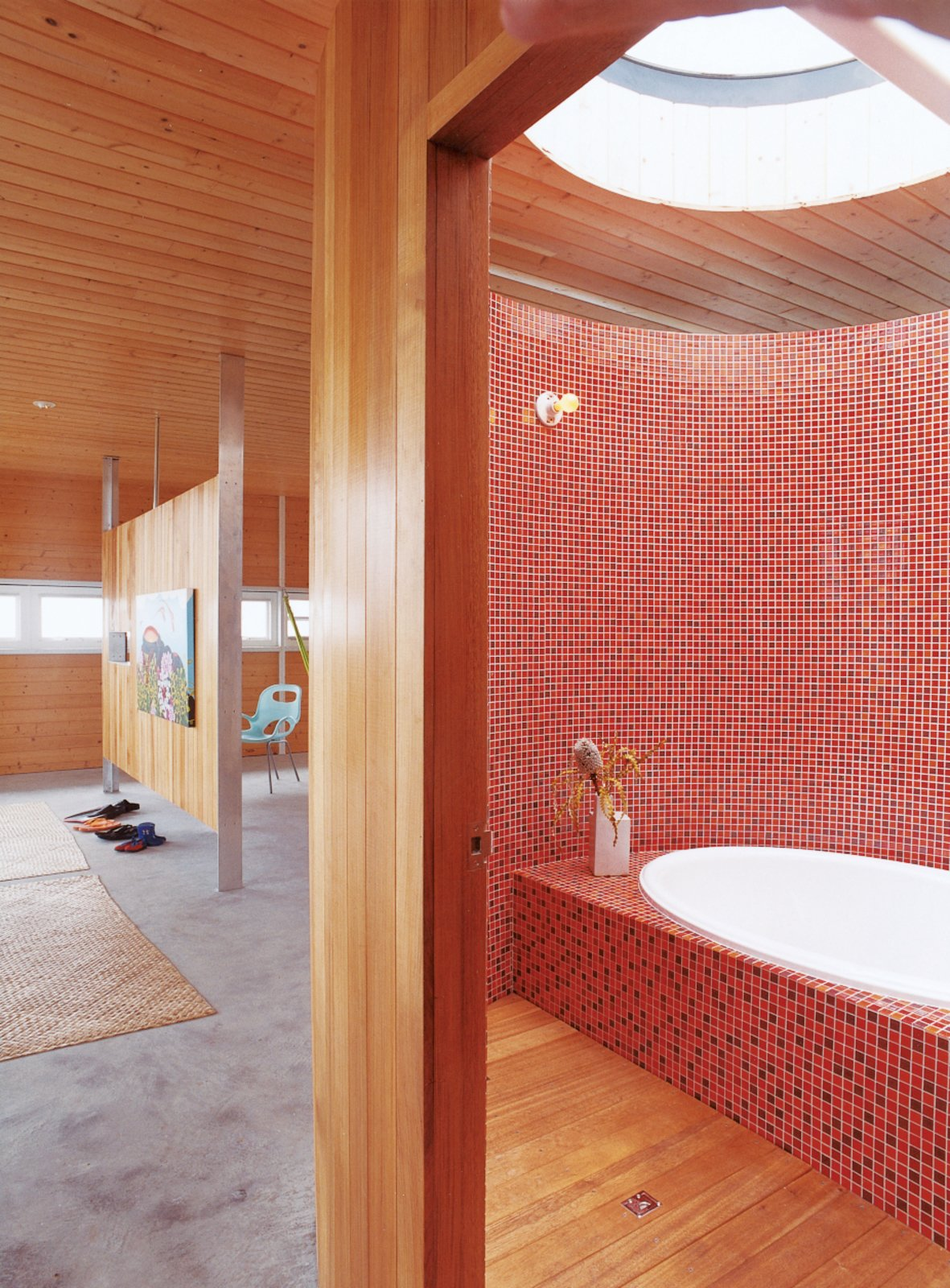 Fiery mosaics tile the majority of this Hawaiian tub room. Built and occupied by architect Craig Steely and his wife, the rest of the home is just as warm and tranquil aptly named Lavaflow 2.  Photo 20 of 20 in 20 Bathrooms With Transformative Tiles