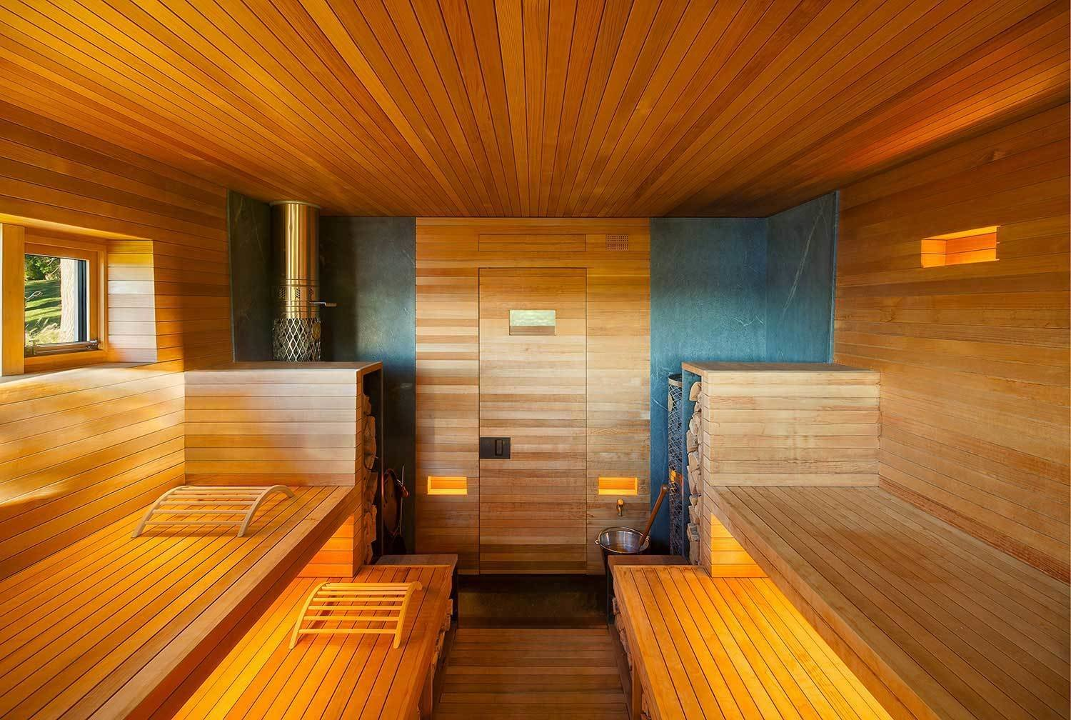 This sauna designed Andre Tchelistcheff Architects stays warm in the well-lit rolling hills of upstate New York.
