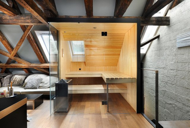 A rustic interior paired perfectly with this Küng Sauna's ultra modern look.