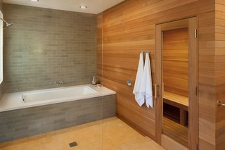 10 Sterling Saunas in Modern Homes - Photo 6 of 9 - Natural wood warms the stone palette of this master bathroom designed by Mark Reilly Architecture.