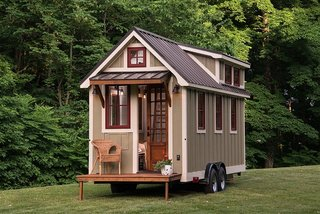 This mobile tiny house by Timbercraft Tiny Homes is 150 square feet of southern charm.