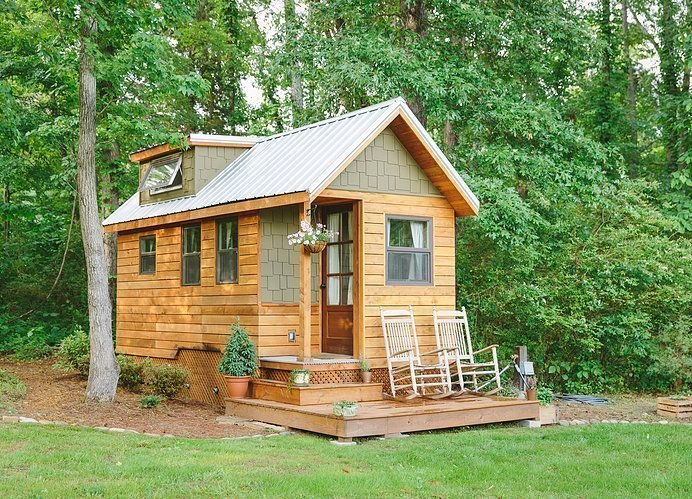Chattanooga's Wind River Bungalow was the first tiny house built by Travis Pyke of Wind River. Cedar sidings are met with interior oak surfaces and storage.